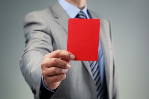 IRS Agent Showing Red Card for Willful Violation of FBAR Reporting Requirements