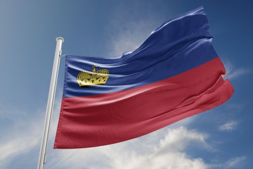 Liechtenstein flag is waving at a beautiful and peaceful sky in day time while sun is shining.