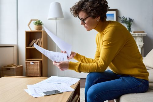 woman reviewing tax documents
