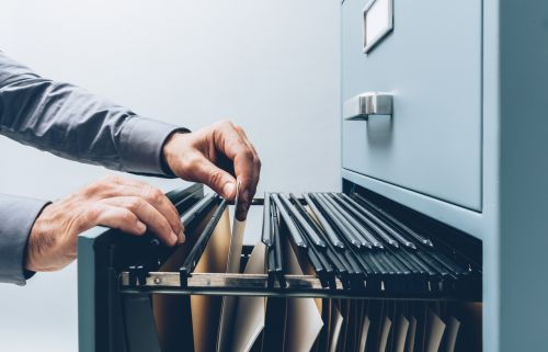 searching for files in a filing cabinet