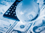 International Currency, Globe, Calculator Symbolizing Taxes of Covered Expatriate
