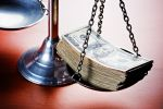 Scales of Justice weighing cash