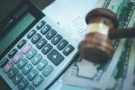 Gavel, calculator and money